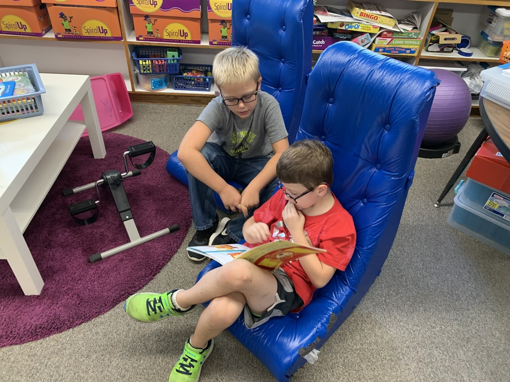 First grades reading to third grade during KRR afterschool programming