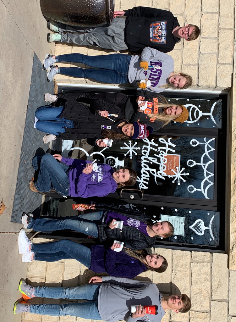 Art Students paint windows on the BR square for holidays