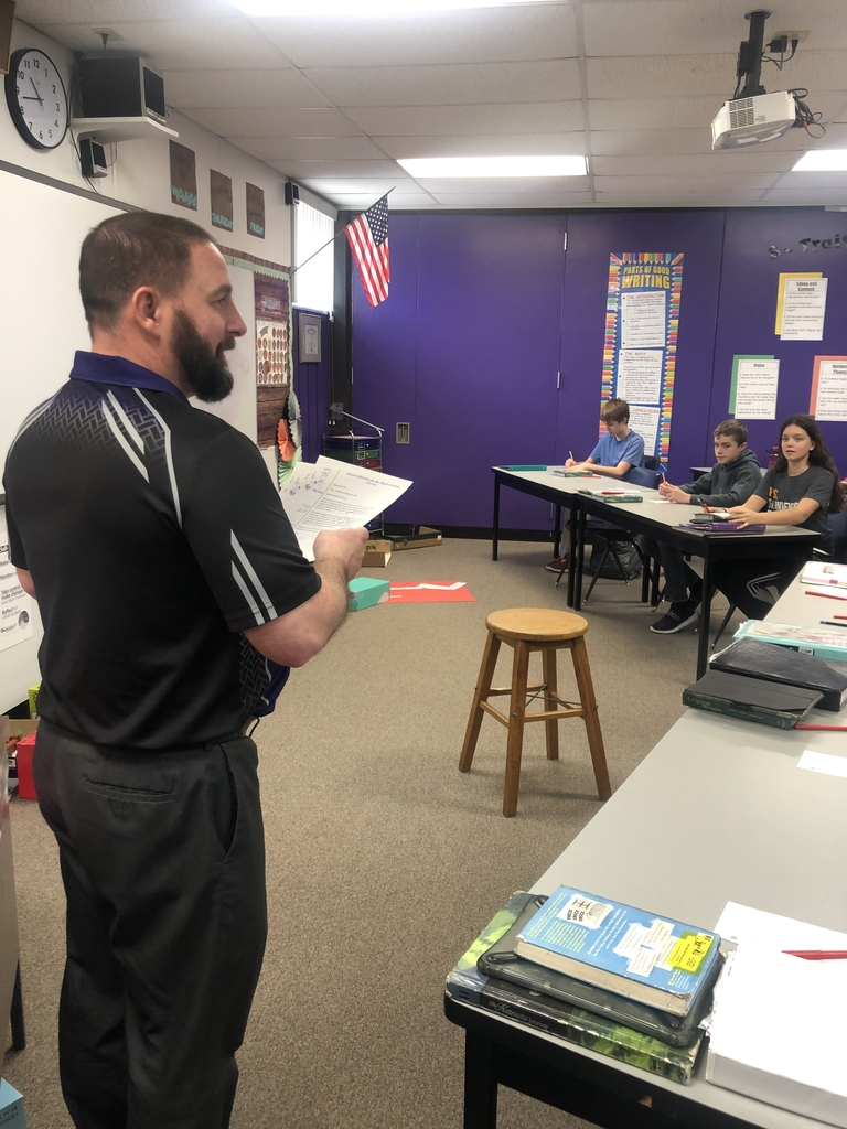 Mr. Kenworthy delivering letters to 7th graders.